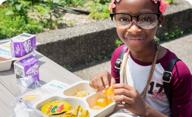 Little girl with healthy lunch