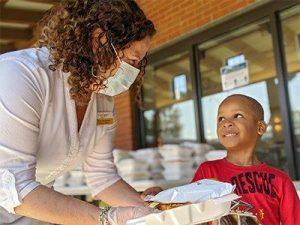 Volunteer speaks to child